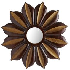 It's always the right season for planting this floral mirror in your home. Boasting a rich, mango wood construction, it alternates between earthy browns and stunning golds. A unique pairing, for sure—one that allows a global vibe to take root.
