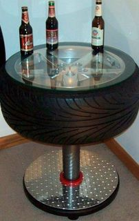 Car parts as everyday household items *For the Man Cave - a cool tire table. Tire Table, Tire Chairs, Tire Craft, Car Furniture, Automotive Furniture, Automotive Decor, Furniture Ideas, Man Cave Furniture, Furniture Design