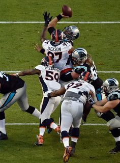 . Cam Newton (1) of the Carolina Panthers gets pressured by the Broncos defense in the second quarter. The Denver Broncos played the Carolina Panthers in Super Bowl 50 at Levi\'s Stadium in Santa Clara, Calif. on February 7, 2016. (Photo by Helen H. Richardson/The Denver Post)