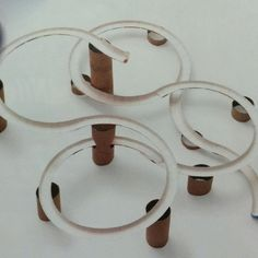 Paper plate edges + cardboard tubes = marble racetrack.  Family Fun magazine.