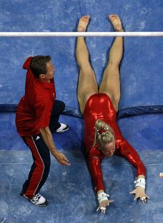 :( Nastia Liukin falls off the uneven bars in front of coach, Valeri Liukin during day 4 of the 2012 U.S. Olympic Gymnastics Team Trials at HP Pavilion on July 1, 2012 in San Jose, California.