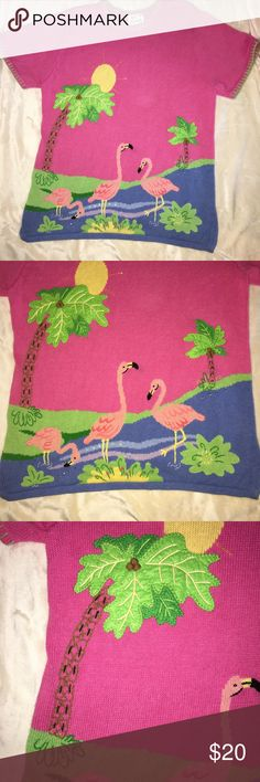 """Quacker Factory Flamingo Sweater Tunic.  Size XL. Beautiful shorty sleeved sweater tunic by Quacker Factory.  A part of the Summer Scenes Collection.  Bright pink with palm trees and flamingos.  All over intarsia, embroidered accents, beads, sequins, and contrasting whipstitching around neck and sleeves.  Size 1X (18-20).  30"""" length and 50"""" chest measurements. 55% ramie / 45% cotton, exclusive of ornamentation. Excellent gently loved condition. Quacker Factory Sweaters Crew & Scoop Necks"""