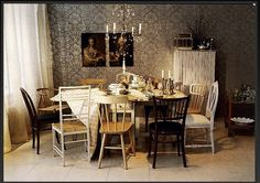My idea of the perfect dining room set - nothing matches, yet they look great together.