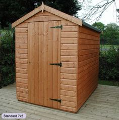 add a wee bit of 2 x 4 and a wooden diamond above the door to give the sauna a real beach hut look