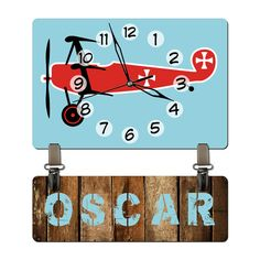 Customized and Personalized Children Kid's Birthday Gift Wall Clock for Boy's Rooms with a Vintage Airplane Theme Decor Quartz (not plastic). $27.99, via Etsy.