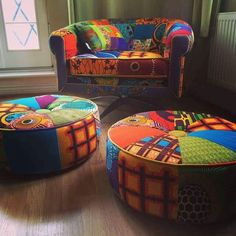 Bespoke Afrotechicolour Dutch waxblock print (courtesy of YouMeWe) & European furnishing fabric patchwork mid century modern chair , scatter cushion and Ottoman stools created by Ray Clarke
