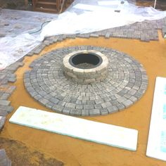 Fire pit with encompassing brick