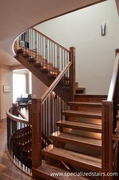 Walnut Staircase | Open Riser | Curved Railing | Custom Stairs | Newel Post | Metal Baluster | Wood Stairs | Architectural Staircase | Wood Grain | Iron Spindles | Gibson Handrail | Flag and Blank Spindles | Mission Post | www.CustomNewelPosts.com