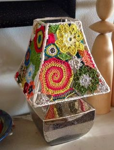 Random Crocheted Lamp ShadeThe Fiber Lounge shares a post on how she made this crocheted lamp shade. In her post you can see all the bits and pieces as there were being created.