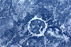 meteor crater in Canada from space, photo by astronaut Andre Kuipers