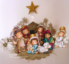 Gorgeous creation by Jane Johnson featuring several images from the Nativity Collection by Magnolia