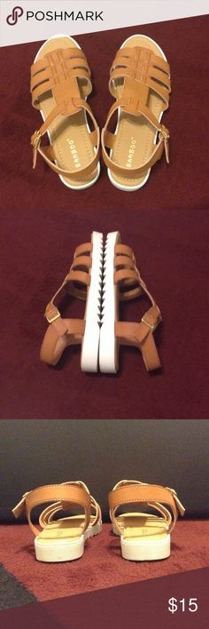 ✨✨✨GLADIATOR SANDALS✨✨✨ New; never worn; faux tan leather upper; side faux gold buckle closure; white bottom; original shoe box included Bamboo Shoes Sandals