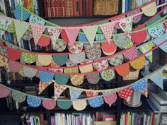 Made a bunting with triangles out of scraps today!  This was a good inspiration.