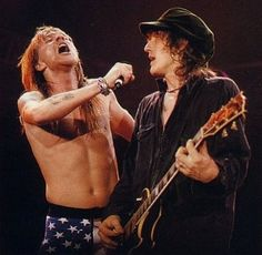 Axl looks like he's about to sneeze on Izzy Stradlin! God Bless You!