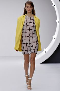 I do struggle to click with Topshop Unique, but this yellow jacket looks great with the checked dress - Topshop Unique Spring RTW 2013