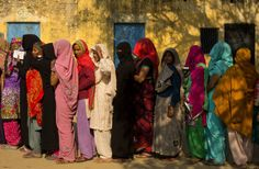 Photos of the day - February 15 2017Indian women stand in line...  Photos of the day - February 15 2017  Indian women stand in line to cast their votes at a village near Amroha in Uttar Pradesh India; a general view as runners turn down the side of the track at Towcester Racecourse in Towcester England; President Trump and first lady Melania Trump await the arrival of Israeli Prime Minister Benjamin Netanyahu at the White House in Washington D.C.; Filipino farmers water their plants at a…