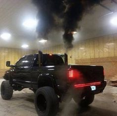 # Ram Rolling Coal; http://www.kathleenandronpescatore.thesmartmoneysystem.biz/ Those taillights are cool and that red light bar below the tailgate
