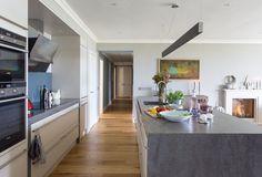 Concrete counters--Contemporary Kitchen by Camilla  Pringle Interiors