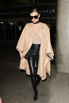 Miranda Kerr Styling Takeaway: A camel cape is a no-fail way of looking chic this season. Pair the outerwear with leather leggings for the perfect contrast.