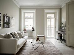 A calm Swedish home in neutrals (and a fab fireplace)