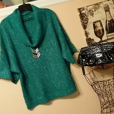 Notations XL cowl neck sweater Cowl neck sweater by Notations in green and white,  elbow length wide sleeves with ribbing at cuffs and  ribbing around waistband.  In great preloved condition.  92% acrylic and 8% metallic. Silver threading runs throughout sweater. Notations Sweaters Cowl & Turtlenecks
