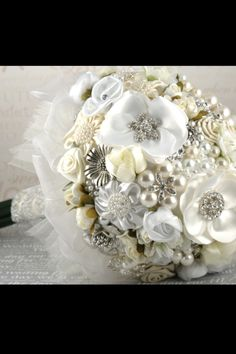 Bride & bridesmaid bouquets. I would love to handmake the bridal bouquets similar to this design using rings, brooches, hair pieces etc. Very vintage and elegant. These would make such pretty keep sakes!