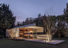 Casa Torcuato Pavilion is a concrete and glass outbuilding with a connected…