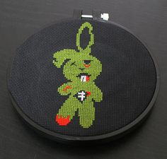 Cross stitch this adorable yet deadly zombie bunny! It is an avocado green, red, light grey/white and black DMC thread on black aida 14 count fabric, but you are welcome to use any colors or fabric! S