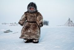 (c) Simon Morris, UK, Entry, Open Compeition, 2015 Sony World Photography Awards 'On the Tundra.' by Simon Morris A Young Nenets boy plays in degrees on Yamal in the Winter in Siberia. Photographie National Geographic, National Geographic Fotos, National Geographic Photo Contest, National Geographic Photography, World Photography, Photography Awards, Photography Pics, Stunning Photography, We Are The World