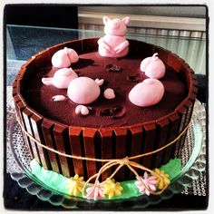 Pigs in Mud Cake! Chocolate cake with chocolate ganache on the top and jam in the middle and fondant pigs!
