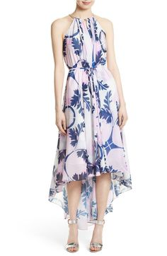 Botanical prints make this statement hi-low dress perfect for any soiree