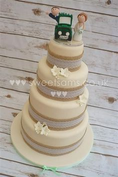 Burlap/ hessian and lace rustic wedding cake with bride and groom cake topper in Range Rover