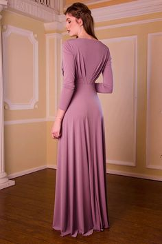The full length Temple dress features a timeless skirt silhouette with delicate waist enhancing pleats on the front and back of the bodice. The bateau neckline and full length sleeves are demure and elegant and prove that less can definitely be more. The Temple dress is shown here in Heather but is available in other colours also. Our dresses epitomise grace and elegance and have all been skillfully designed to give the most flattering fit and appearance. Our luxurious jersey...