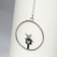 Gorgeous pendant featuring a tiny oxidised silver bird box with a hand painted pale blue aluminium back, a silver bird and a tiny silver heart. This is set in a textured irregular silver circle and hung from a 16 inch sterling silver chain. Oxidized Silver, Sterling Silver Chains, Necklace Box, Pendant Necklace, Kraft Gift Boxes, Bird Boxes, Hand Illustration, One Pic, Hand Painted