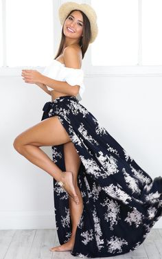 This cute navy and white floral print features a tie up waist and a side split. Match this with a cropped top, sandals and a straw hat for a chic beach outfit