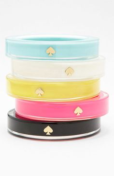 Now marked down! I want the black, no yellow, no white!!  Style, Decor and More! http://stylendecordeals.blogspot.com/2013/04/kate-spade-spring-bangles-add-pop-of.html