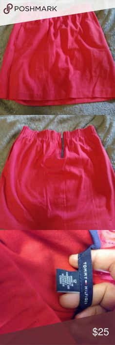 Tommy Hilfiger Skirt Red Tommy Hilfiger skirt with zipper. Bottom of skirt sits right at the bottom of the knee. Waist has a stretch to it and there is a zipper in the back Tommy Hilfiger Skirts Midi