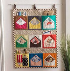 Patchwork wall pocket. I could think of several uses for this.