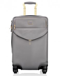 """With its brass hardware and gull-gray leather, Tumi's """"Sinclair Blair"""" is at home in first class—and economy ($1,195)."""