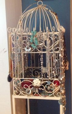 """My Jewelry storage:  I spray painted a bird cage with lots of hooks a nice antique white. It is on a stand that came with it. Found it at a """"garden gate"""" store. Holds a lot, have bracelets & watches inside, some hanging."""