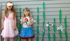Mermaid party picture backdrop - cute! We're going to color the fish together before the party as a little family project :)