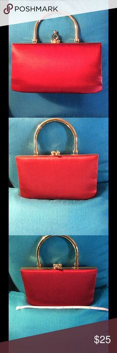 Red satin clutch Red satin clutch with gold hardware; solid gold half circle handle and long shoulder strap; small mirror inside purse for lipstick or makeup touch up! Bags Clutches & Wristlets