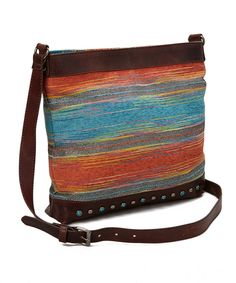 I Love Accessories Blue & Orange Abstract Stud Crossbody Bag   zulily 11'' W x 11'' H x 3'' D 25'' max. strap drop Cotton / zinc / leather Magnetic closure Interior: one zip pocket Imported