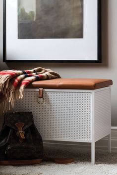 Frank is a Swedish-made storage bench. The bench is made of perforated metal with black or white powder coating and the seat is composed of naturally tanned leather from Elmo in either cognac or black. A neat storage bench for the hall or even the bedroom.