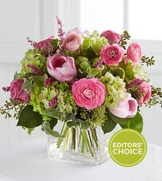 FTD® presents the Better Homes and Gardens® Blooms of Hope Bouquet.  Gorgeous lavender roses sit amongst green hydrangea, pink ranunculus and pink tulips, offset by lavender heather, English ivy and seeded eucalyptus. Beautifully brought together in a clear glass rectangular vase, this bouquet extends hope and cheer for the sunnier days ahead.  Proceeds from this bouquet go to the Haiti Relief Fund, that we may further the effort to help those in need and build a brighter future for all.