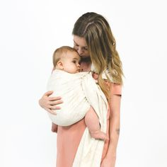 Sakura Bloom Malt, gold rings. This perfect neutral comes to life with a decadent texture of cream and barley. sakurabloom.com  .............................................   Raw silk fibers spun and then handloomed to create a cloth full of charm and texture, and with incredible support. Crafted from a single layer of raw handloomed silk. One size, adjustable baby ring sling. Newborn-35lbs.