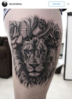 Black and grey realistic lion tattoo with roses