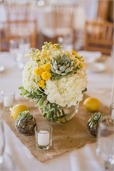 Burlap and succulent wedding centerpiece idea.
