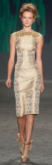 vera wang's golden dress is elegant and oh-so fashionable for this holiday season
