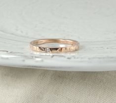 This ring is made of solid recycled 14k Gold which I hammered to give it a textured finish and character. The inside of the ring band is smooth and polished for beauty and comfort. Measurements approximately 2mm wide x 1.5mm thick. Diamond Measures 1.5-1.7 mm in diameter *Gold